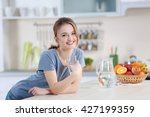 young woman drinking water from ... | Shutterstock . vector #427199359