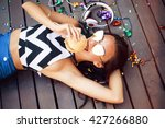 funny hipster girl laying on... | Shutterstock . vector #427266880