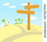 wooden signpost at crossroads... | Shutterstock .eps vector #427267594