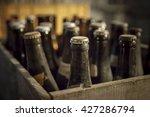 old dusty bottle of beer in a... | Shutterstock . vector #427286794