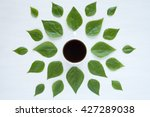 black coffee and green leaves... | Shutterstock . vector #427289038