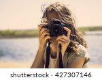 beautiful girl on the beach... | Shutterstock . vector #427307146