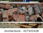 bricks in a dumpster near a... | Shutterstock . vector #427331428