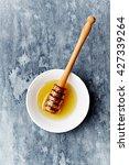 organic honey with honey dipper | Shutterstock . vector #427339264