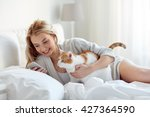 Stock photo technology pets communication and people concept happy young woman with cat and smartphone 427364590