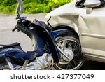 motorcycle accident with a car. | Shutterstock . vector #427377049
