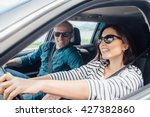 happy couple goes by the car | Shutterstock . vector #427382860