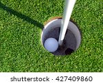 Golfball With Flagstick And...