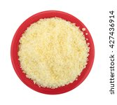 Small photo of Top view of a small bowl filled with grated Pecorino Romano cheese isolated on a white background.