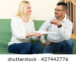 smiling agent giving to... | Shutterstock . vector #427442776