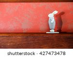 the rabbit toy over the wooden... | Shutterstock . vector #427473478