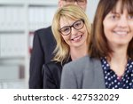 three smiling business people... | Shutterstock . vector #427532029