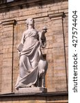 Small photo of Gatchina Palace. Sculpture at the front door. Allegory - vigilance. The sculptor Johann Morleyter.