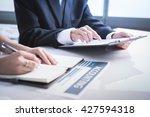 business adviser analyzing... | Shutterstock . vector #427594318