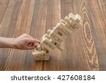 hands of man pushed the brick... | Shutterstock . vector #427608184