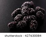 Frozen Blackberries On A Black...