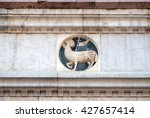 Small photo of FLORENCE, ITALY - JUNE 05: Agnus Dei carrying a Christian flag, Portal of Cattedrale di Santa Maria del Fiore (Cathedral of Saint Mary of the Flower), Florence, Italy on June 05, 2015