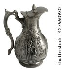 Small photo of Antique pewter pitcher with a beautiful relief and cover isolated on white background