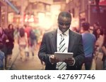 happy businessman checking his... | Shutterstock . vector #427697746