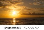 spectacular sunset over calm... | Shutterstock . vector #427708714