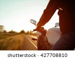 moped drivers on road at sunset ... | Shutterstock . vector #427708810