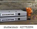 Small photo of Accounting and Accounting - two folders on wooden office desk