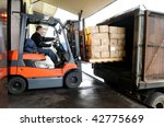 Electric Forklift In Warehouse...