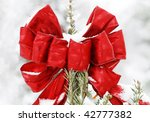 red bow on outdoor tree with snow - stock photo