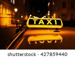 taxi sign on the roof of a taxi ... | Shutterstock . vector #427859440