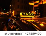 taxi sign on the roof of a taxi ... | Shutterstock . vector #427859470