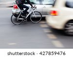 cyclist in city traffic in... | Shutterstock . vector #427859476