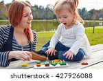 mother and daughter playing... | Shutterstock . vector #427926088