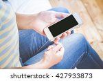 woman reading phone while is... | Shutterstock . vector #427933873