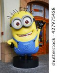 Small photo of SINGAPORE - 06 MAY 2016: Human Size Minion Model at Universal Studios