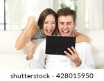 front view of an excited couple ... | Shutterstock . vector #428015950