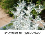 pyramid of glasses of champagne.... | Shutterstock . vector #428029600