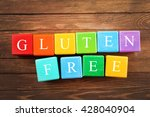 Small photo of Gluten-free diet concept. Colorful cubes on wooden background