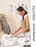 female fashion designer working ... | Shutterstock . vector #42811726