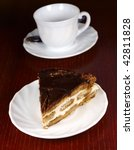 cup of coffee and sweet cake   Shutterstock . vector #42811828