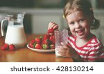 happy child girl drinks milk... | Shutterstock . vector #428130214