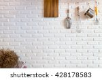 some kitchenware hang on white... | Shutterstock . vector #428178583