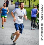 Small photo of BREVARD, NC-MAY 28, 2016 - Christopher Wolf, Littleton, Co, placed 2nd 19-29 age group 10K in the White Squirrel Race in Brevard, NC 2016. Race is sponsored by Rotary Club of Brevard, NC