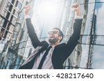 celebrating success. low angle... | Shutterstock . vector #428217640