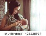caring mother breastfeeding | Shutterstock . vector #428228914