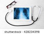 x ray on the tablet screen with ... | Shutterstock . vector #428234398