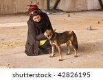 Young Girl With Abandoned Dog...