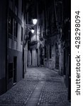 Small photo of Old alley from Oporto by night. High ISO photo.