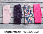 folded colorful pants. woman's...   Shutterstock . vector #428323960