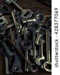 set of keys on wood background... | Shutterstock . vector #428377069