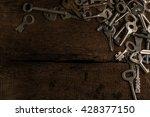 Set Of Keys On Wood Background...